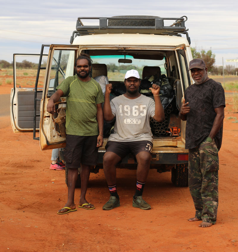 Arts worker Selwyn Nacambala, artist Jayquin Nelson, chairperson Watson Corby with Papunya Tjupi's troopy packed and ready to go with artworks ahead of the art centre temporarily closing on 10 April. Courtesy Papunya Tjupi Arts