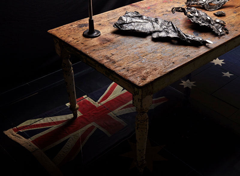 Louisann King, arbor temporis momentum – chartam (detail), 2017, bronze, vintage scientific glass tubes, early Australian pine table, vintage steel stand, vintage cotton handmade Australian flag, vintage window glass. Photo: Danny Wootton