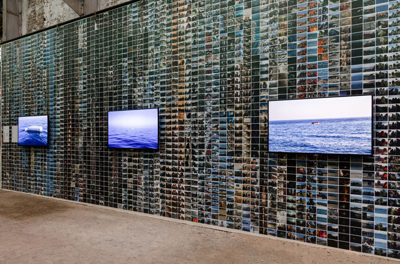 Installation view. Wall of photos by Ai Weiwei