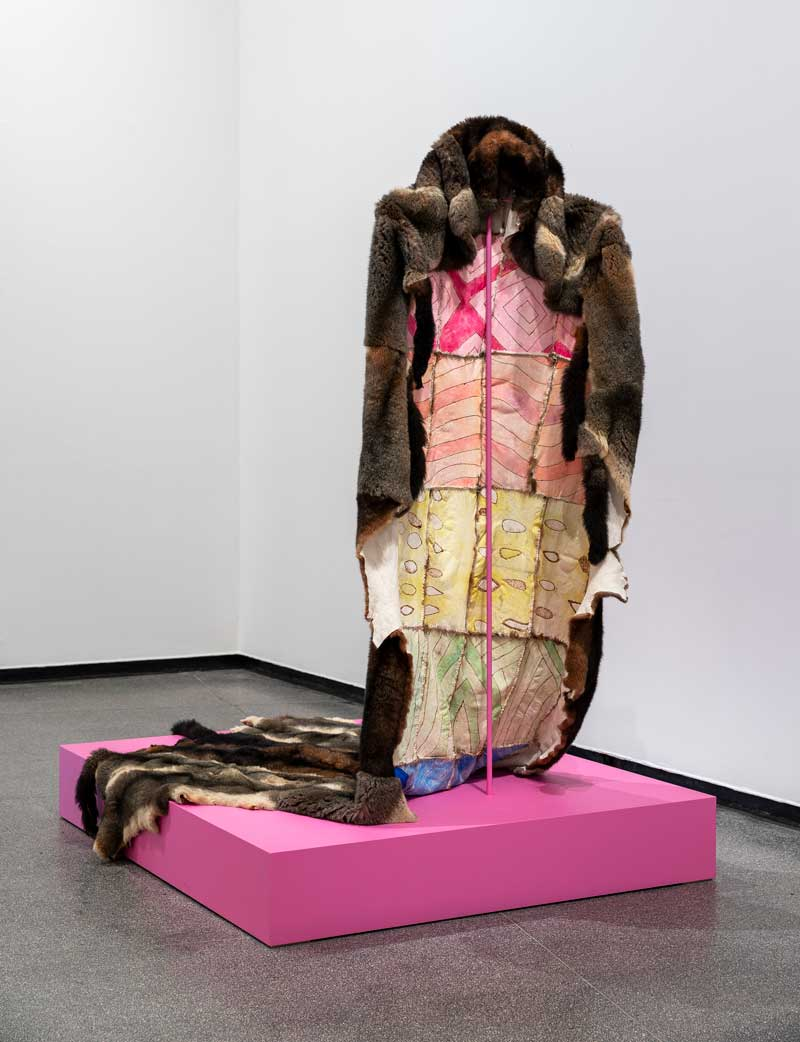 Peter Waples-Crowe, Ngarigo Queen – Cloak of Queer Visibility, 2018 possum pelts, waxed linen thread, leather dyes, pokerwork. Installation view, Australian Centre for Contemporary Art, Melbourne. Cloak‐making adviser: Maree Clarke. Courtesy the artist and the Australian Centre for Contemporary Art. Photo: Andrew Curtis. © Peter Waples‐Crowe/Copyright Agency, 2019