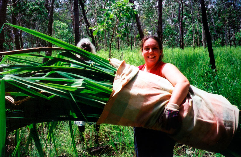 Rebecca carrying pandanus leaves. Courtesy Lockhart River Arts Centre