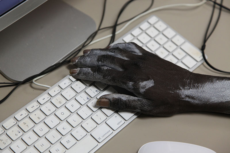 Photo of Yolngu hand on the keyboard