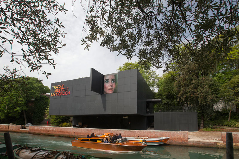 The Australian Pavilion, canal-side exterior of the Australian Pavilion, showing the work Vigil from Tracey Moffatt's My Horizon