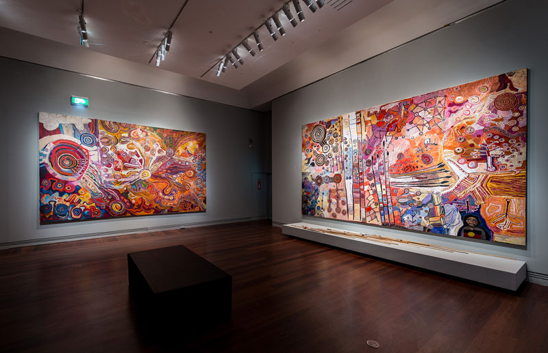 Men's and Women's paintings from APY Lands, installation view, Tarnanthi